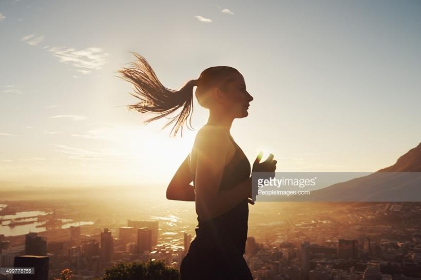 Shot of a beautiful young woman training at sunrise